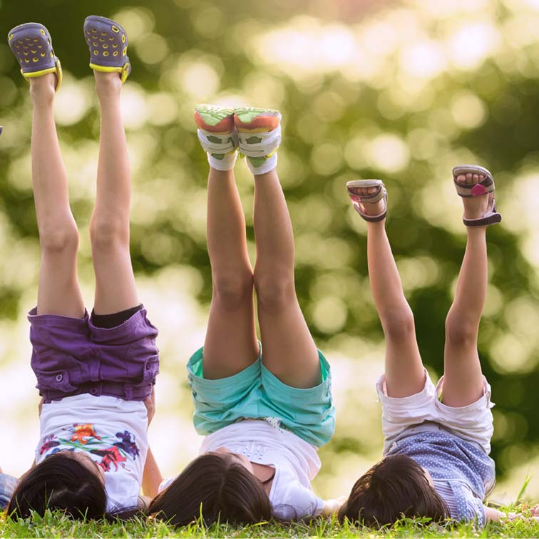 Kids with legs in the air