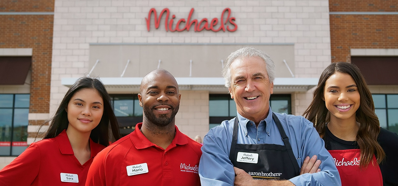 Photo of employees in front of a Michaels store